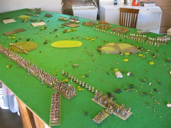 Armies deployed for battle separated by the low hills. Etruscan in foreground, Rome in distance.