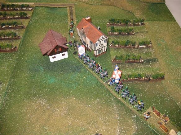 French column advances along the road entering the village of Teixeira.