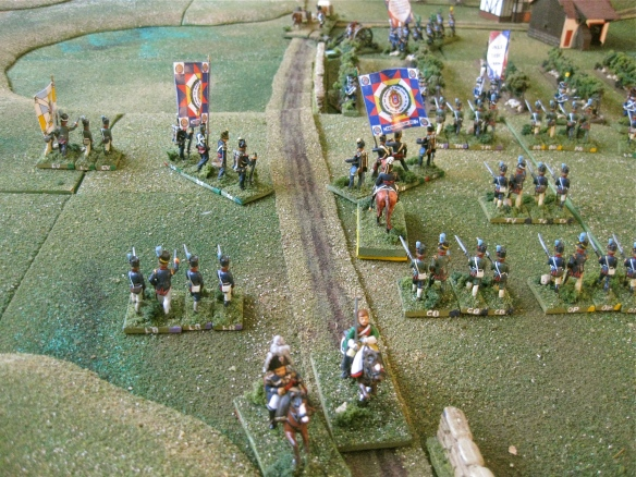 Overrunning the two 3lb cannon, the dragoons ride up the road past the Portuguese infantry.