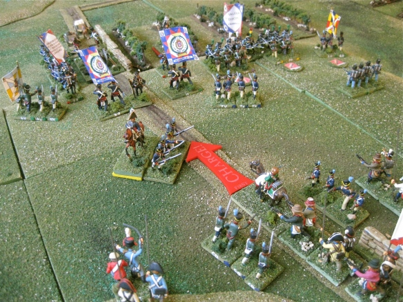 Trapped in the rear, the French dragoons charge back along the roadway as Portuguese Ordenanza with pikes chase them. French legere infantry form up and charge up the steep hillside.