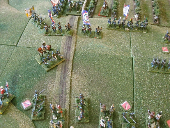 The French dragoons are chased away (off to right) but the French legere infantry break the Ordenanza infantry.