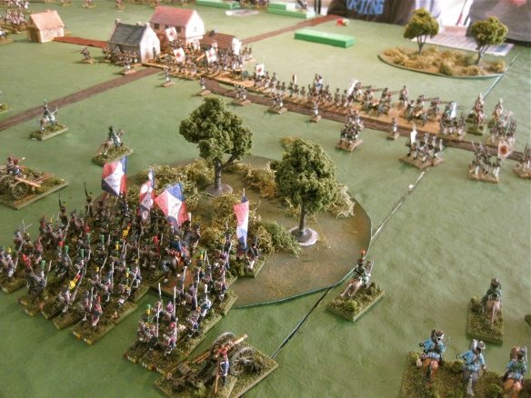 Massed French infantry columns clear the Russian Jagers from the woods.