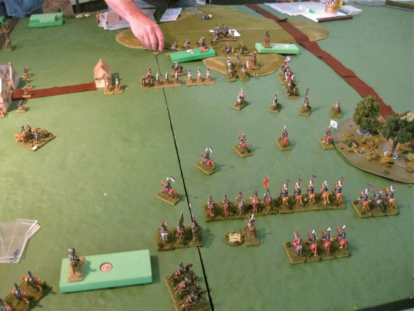 The beat up Russian cavalry rally as another cavalry division arrives alongside (block). Onr the hill the reformed French cavalry join up with their two infantry divisions (in block form)