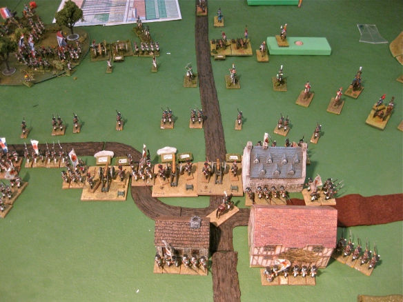 Meanwhile, Russians hold the central town with their artillery batteries (cannon) and infantry division.