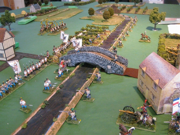 The French artillery bombard the Austrians across the river as their skirmishers take their pop shots.