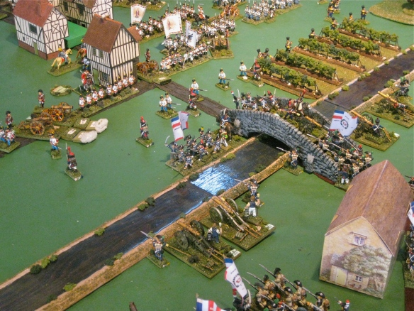 French surge across the river bridge and start to deploy on far bank as the artillery duel each other.