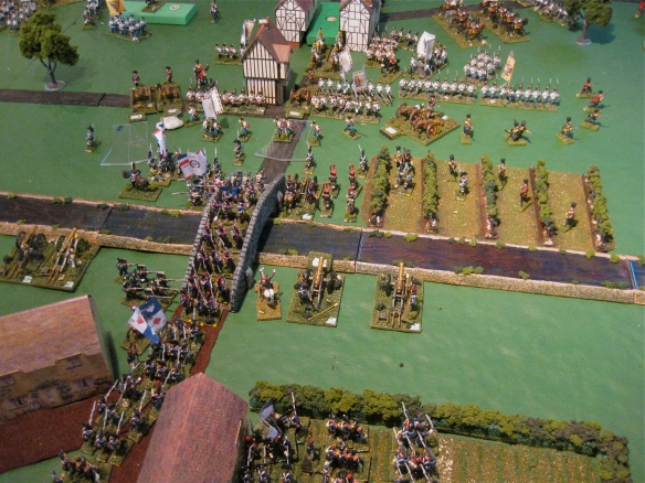 Central action at the bridge. Held temporary by Austrian artillery fire, the French artillery engages their opposites.