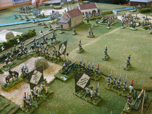 Westphalian infantry (division) advances to the base of the hill before them. French mill about the village. Westphalian chevau-legers prepare to chase away the French skirmishers.