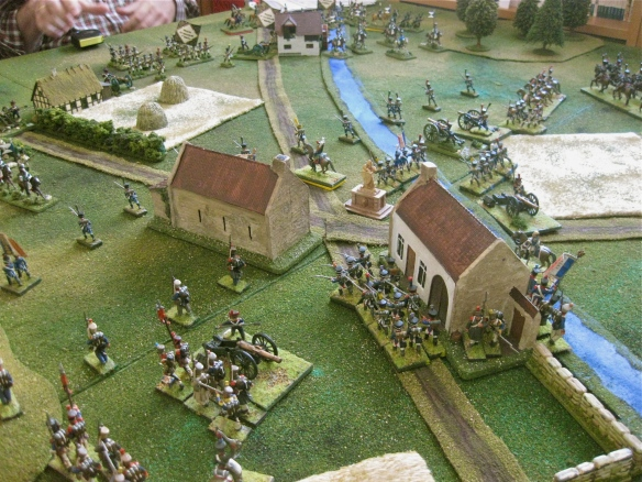 French infantry battalions occupy the village as their skirmishers see the Westphalian cavalry approach.