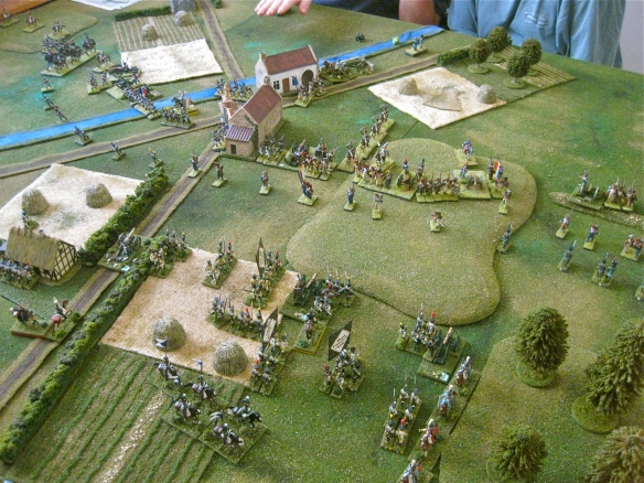 French slowly advance across the raised ground while Westphalian artillery bombards with little effect.
