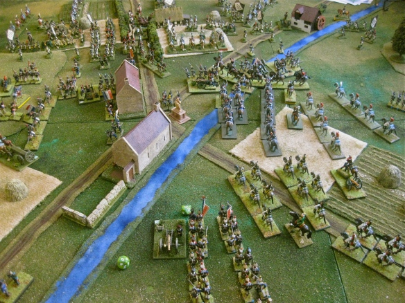 French view of their arriving  heavy cavalry as the Westphalian guard, in distance, nears the village.