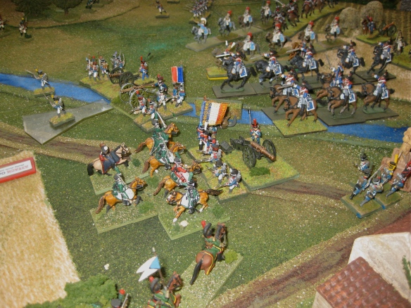 Opening movements. Westphalian hussars charge home on a French battalion in linear formation while French cuirassiers trot forward in column of squadrons.