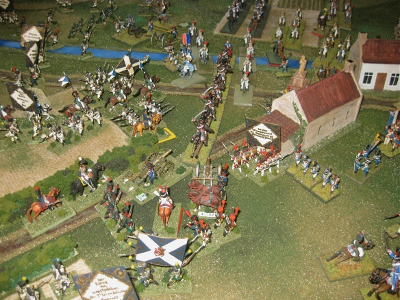 Westphalian infantry in squares, their artillery is faced by charging French hussars.