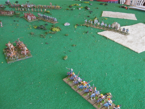 Greek right flank cavalry retires before the Persian left flank advance.
