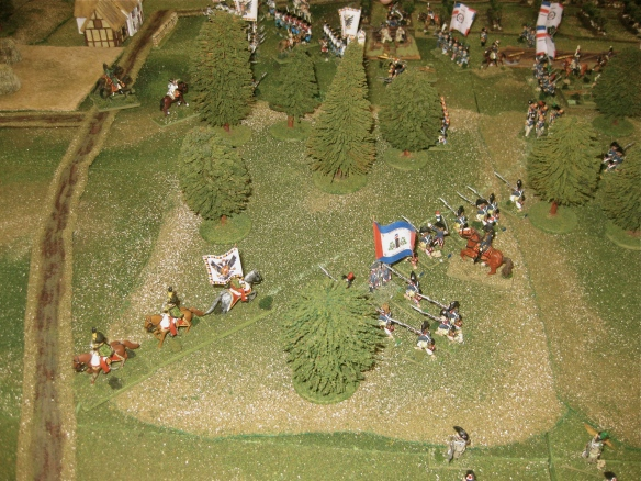 Meanwhile, as more French infantry circle about an march through the woods, the Austrian hussars briefly think of charging down the pathway.... are they nuts?