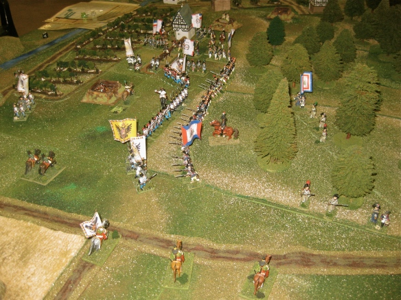 "Another Austrian view of their ""open"" right flank defended by a few hussars squadrons. Skirmishing frenchmen line the woods as the main battle lines volley along the wood edge."
