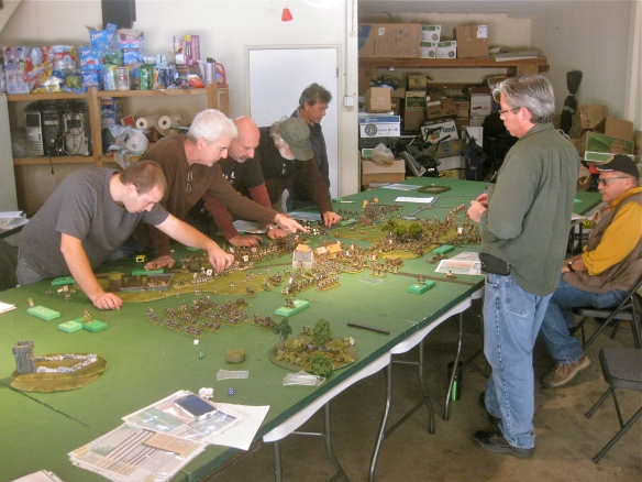 General view of the gaming table. Farside is (l to r); Daniel, Bob, Tim, Dave and Andy. Nearside is Rob and John.