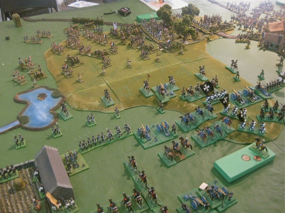 Prussian cavalry retires behind their advancing linear infantry and deploying artillery batteries.