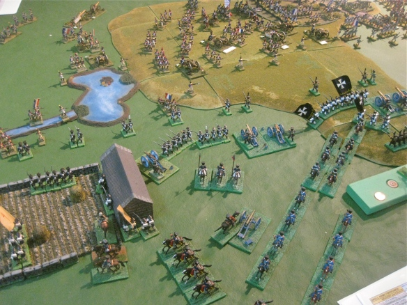 The Prussian cavalry, seeing French cavalry ride out on flank, reposition themselves by  riding to the flank. Massing French columns in distance.