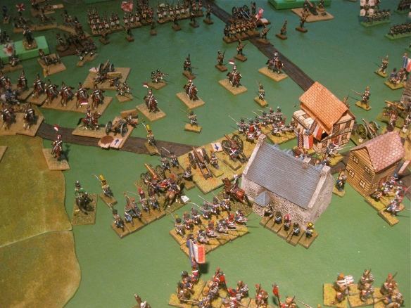 In the town center table the French have cleared the town and start to deploy artillery and infantry to threaten the Russian central position.