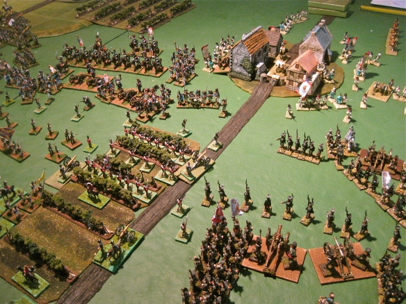 French artillery slowly massing before the British lurking in the vineyard position. Additional Russian infantry comes into play against the Dutch infantry hold firm in the board center.