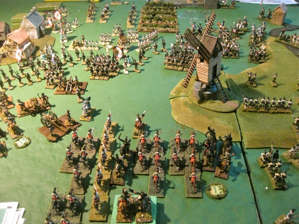 Austrian cuirassiers join the weak Russian cavalry to threaten the distant French and Dutch center infantry. Tim's windmill seeing lots of action at it's location.