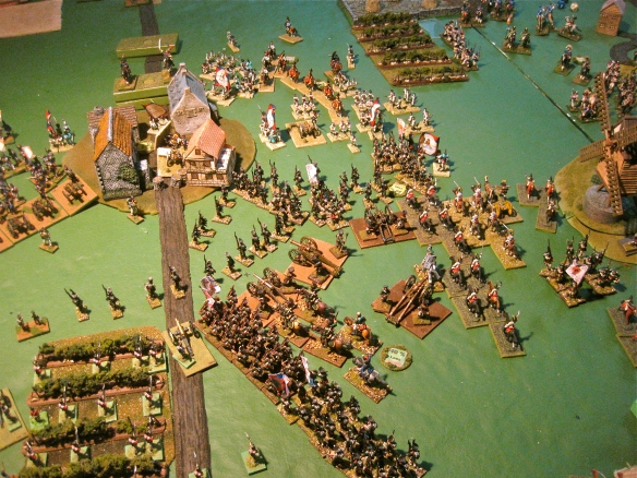 Austrian cuirassier advance while the Russian view of their town assault is pictured. Tim loves big columns...