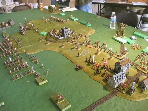 With opening first turn movements completed, the process of miniature deployment started since the armies came into deployment range (adjacent grid squares). French columns support the exposed Danish position.
