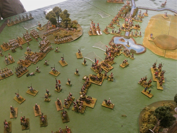 On the French right flank, the French and Vistula legion (Rob's) engaged the Austrians (Greg) anchored in the woods.