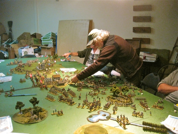 "Dave matches the gaming ""reach"" art form. the difference is WR's cuirassiers are charging into the Austrian cavalry ranks on their side of the tabletop. Rob's French and Vistula legion close in on the Austrian flank woods."