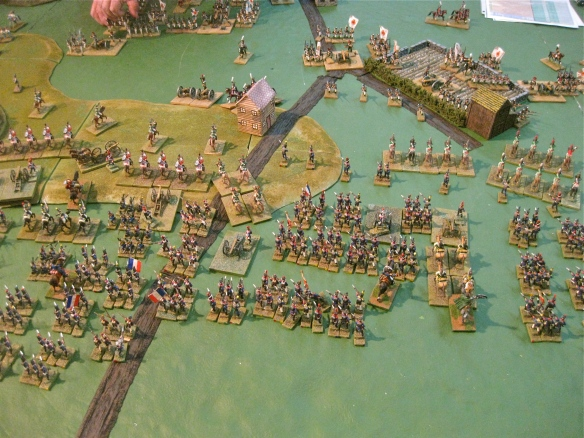 Fronted by their cavalry regiments, the massed French infantry are deployed and advance against the Russians.