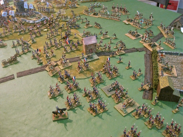 Pushing back the Russian outposts and screens, the French infantry advance seeking battle with the Russians. At top,  French light cavalry charge against the exposed Austrian flank infantry battalions.