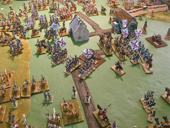 Spanish cavalry riding back under fire from the buildings. The Spanish militia attempt to assault the town. Sharp swords and long barrel muskets poke from the windows. Bob's Bavarians applying some pressure....