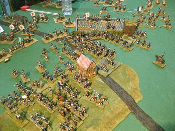 While clearing the farm position, a lone Russian dragoon regiment attempts to charge and slow the relentless French infantry advance.
