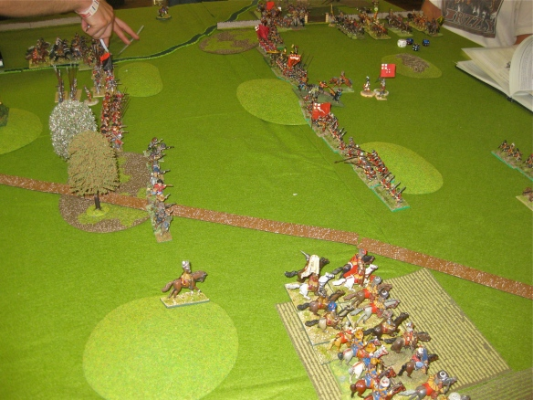The Pikes approach while cavalry secure the open flanks.