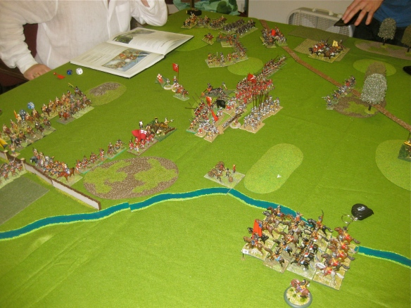 The pike blocks clash in mortal combat while the cavalry of both sides look on.