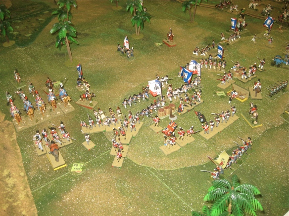 "Trading close range musketry, the French and British infantry battle for the hill. A British ""column"" assaults the open French line as their square holds back the French dromedaries."