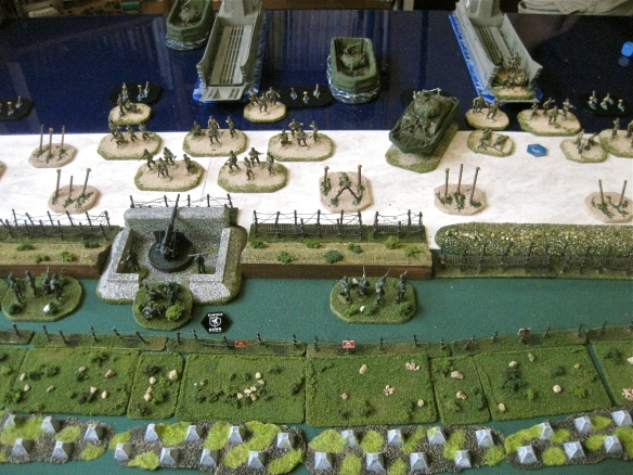Seafront German platoon taking lots of firepower from the landing Americans. One team lost by Preliminary bombardment.