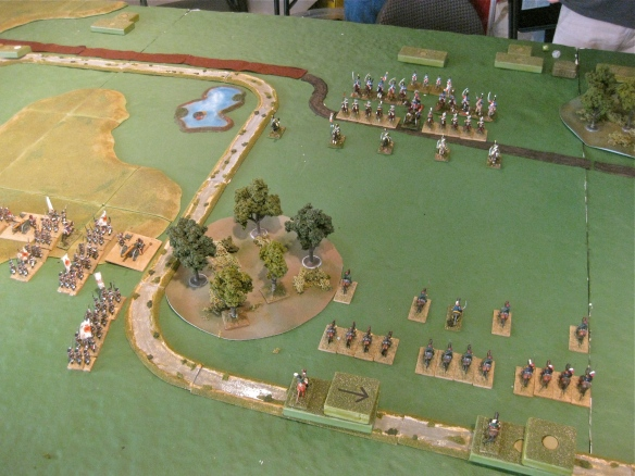 "Towards the Russian left center their cossacks deploy before the French light cavalry division. Behind them are Russian dragoon and infantry divisions in ""battle"" block mode crossing stream."