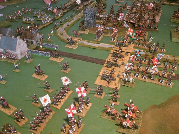 The massed Russian artillery battery goes into action bombarding the town and French. Russian infantry is massed, line division in foreground, then Grenadiers near battery plus two other line divisions near the tower.