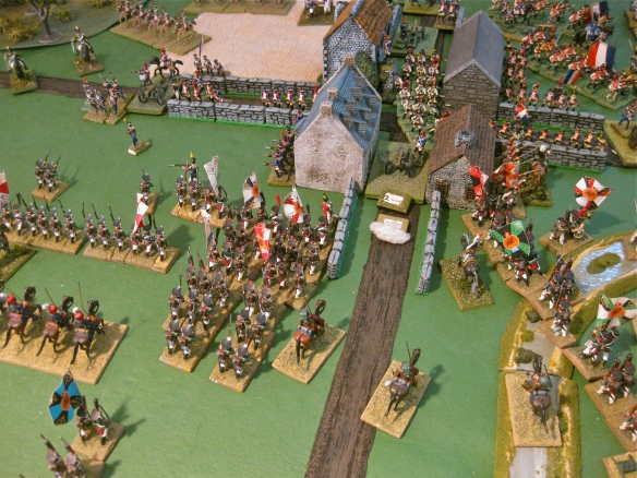 Having taken the corner building with Pavlov grenadiers, the French infantry form their columns and counterattack. Additional Russian grenadiers columns approach the other frontage buildings.