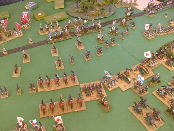 Slowly the Russian left center position advances to push back the French light cavalry. Additional Polish infantry division and soon French cuirassiers will make their appearance.