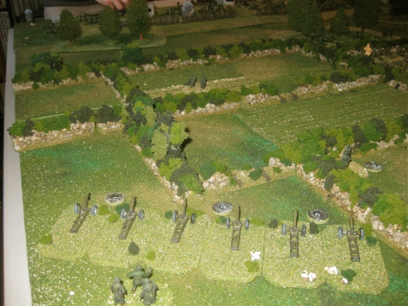 American cannon 105mm platoon (san painted crews) bombard the German hilltop.