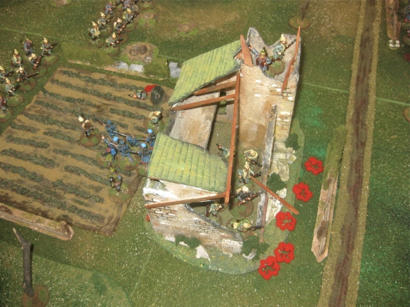 Received token French riflefire, the German infantry and bayonets clear the ruins.
