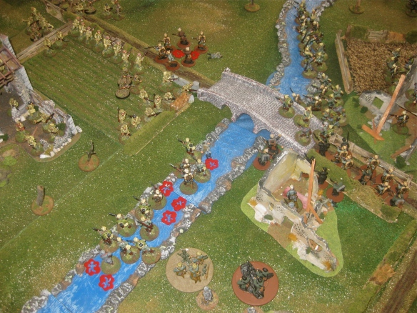 English riflefire rip into the wading German soldiers. Bodies drift with the slow river flow.
