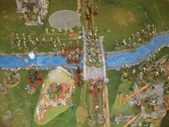 As morater shells land in the English infantry, Teutonic horde rush across the shallow river and the blood stained stone bridge