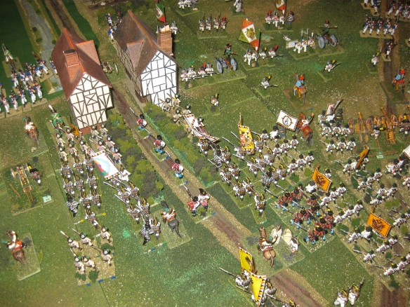 Austrian grenadier columns crashing into Procia. Massed white coat columns are seen marching forward against the weaken Italian division's position.