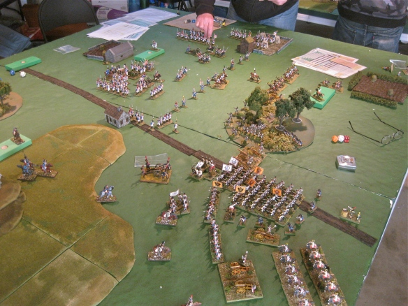 Table A. Massed Austrian columns deploy facing off skirmishing French light cavalry. French infantry in background.
