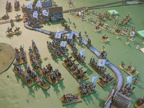 Table B. Bavarian right flank arrives at the stream while Bavarian infantry columns storm the central village. Bavarian cavalry division riding hard for the flank exit edge.