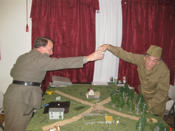 Another Bolt Action scenario set in the Russian countryside. Fellow gamers pulling chits of play.